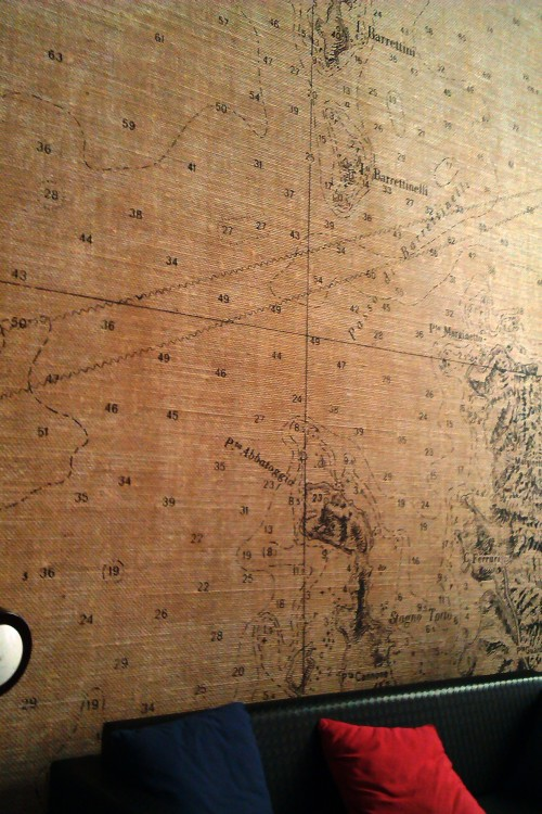 Blown up nautical charts on the wall of Zoc