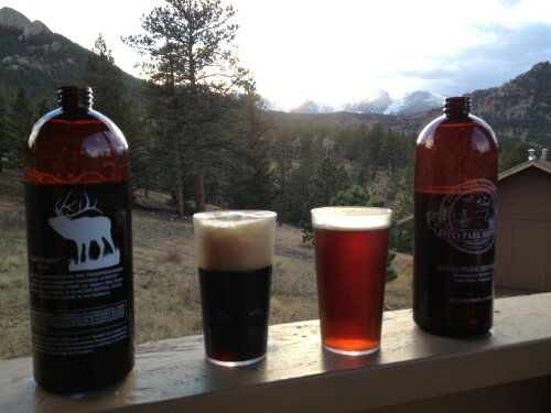 Baby Bugler 2 pint bottles of Estes Park Porter (left) and Redrum Ale (right), with Rockies sunset