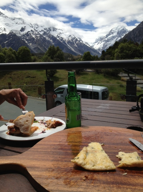 Pork sandwich and pizza at the Hermitage, Aoraki/Mount Cook in the distance
