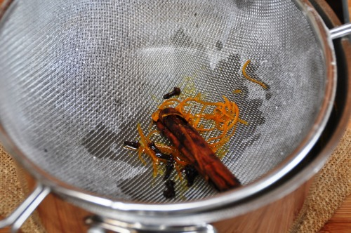 Revani - pour syrup over, straining out the spices