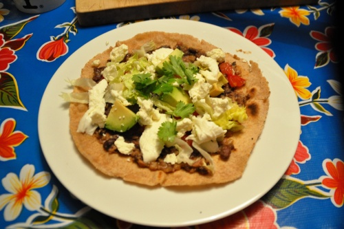 Wholewheat tortilla with toppings - the tlayuda