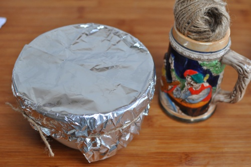 Seal the pudding basin with foil and string